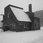 Portiershuisje in de sneeuw